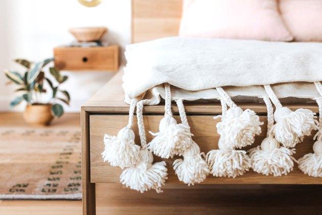 pom poms on blanket in bedroom