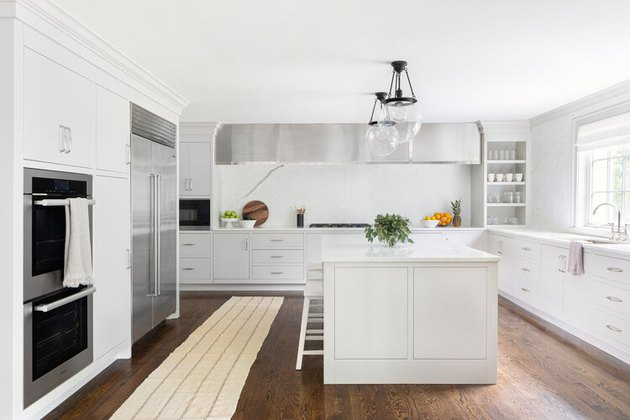minimal style kitchen with white cabinets