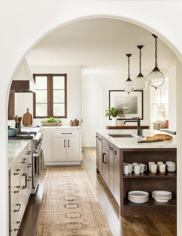 country kitchen with rustic kitchen island and three pendant lights