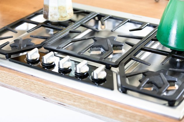 gas cooktop with pot on top