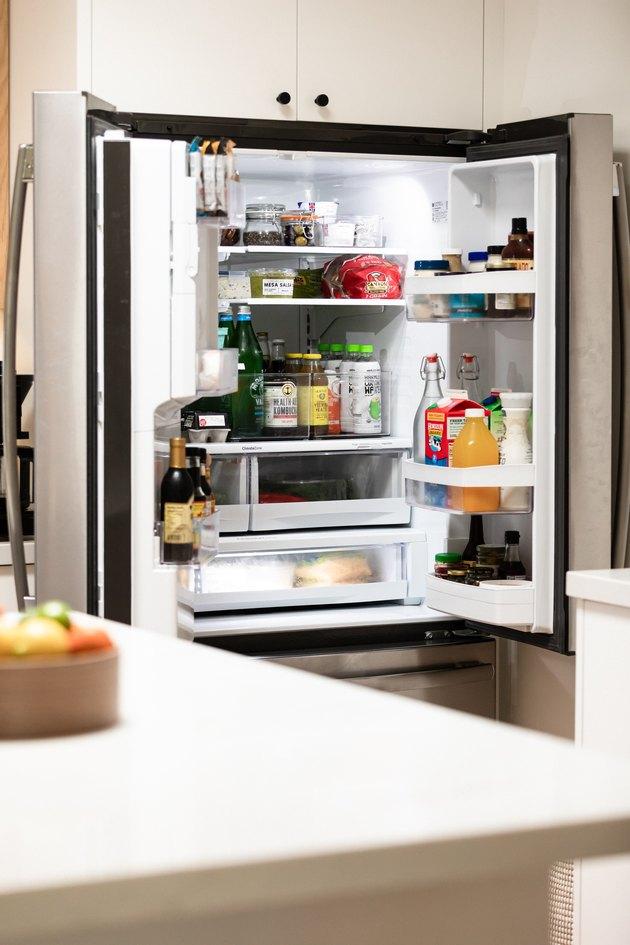 stocked fridge with double doors- open
