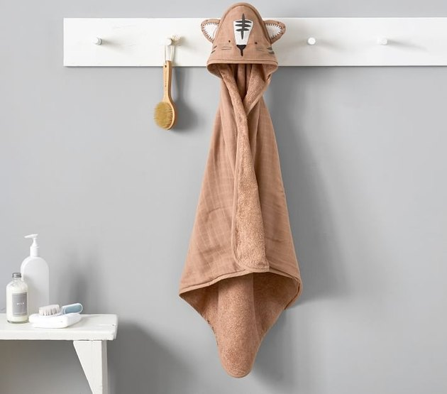hooded kids towel hanging on white hook