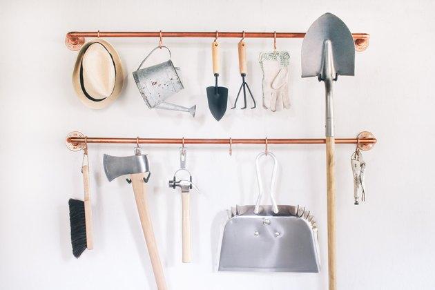 Copper pipe garage tool organizer