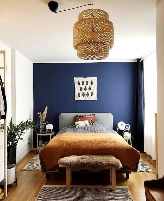 blue bohemian bedroom with IKEA pendant and mustard bedspread