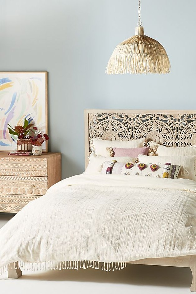 light blue bohemian bedroom idea with tan furniture and hanging pendant