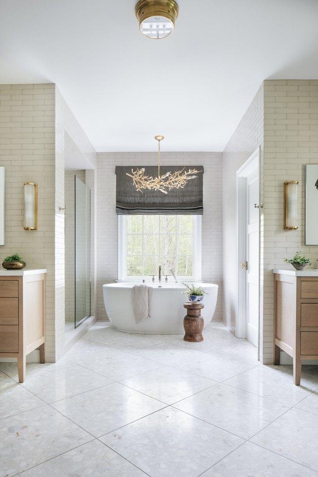 elegant bathroom lighting idea with gold branch-inspired chandelier