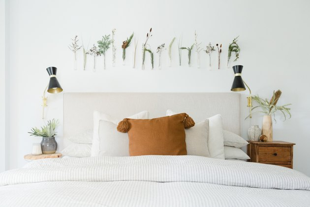 Bed with flowers and plants on wall