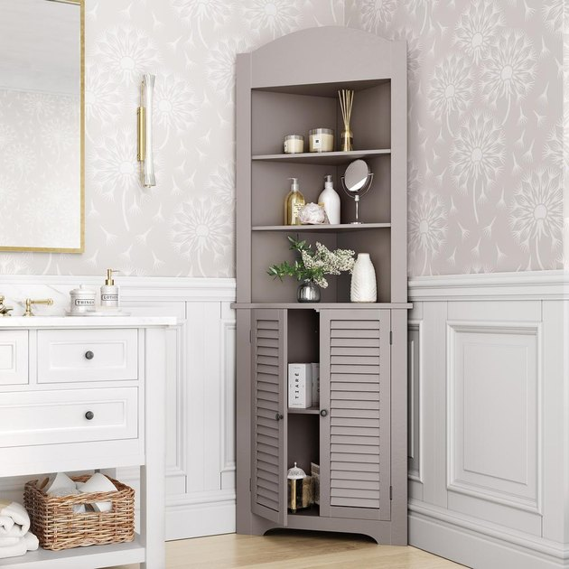 Taupe Corner Bathroom Cabinet in traditional bathroom with chic finishes