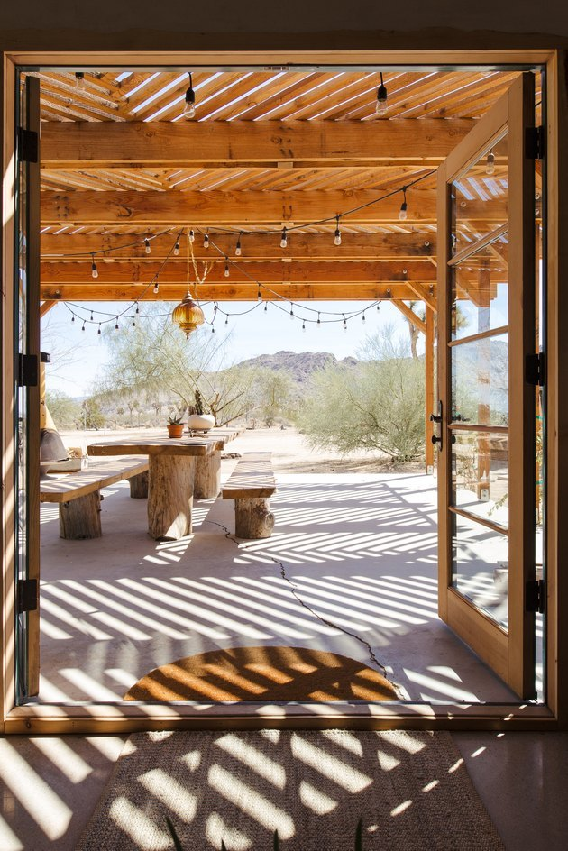 patio dining area with pergola and French doors