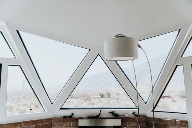 inside a dome addition built in the 1970s with modern floor lamp and desert views