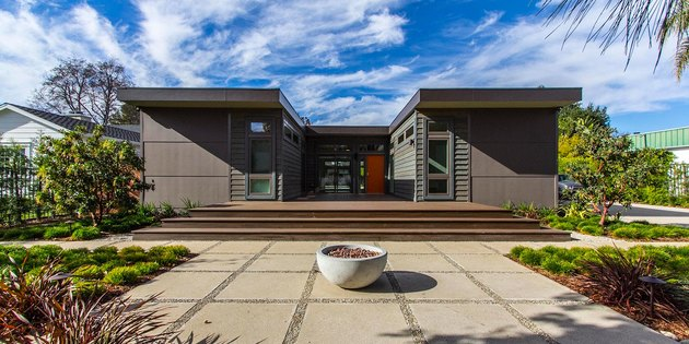 U-shaped modern prefab home with entryway courtyard