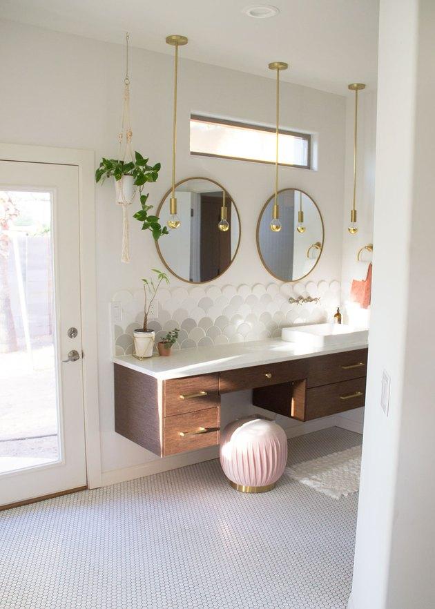 Scalloped art deco tile backsplash in white and gray in art deco bathroom