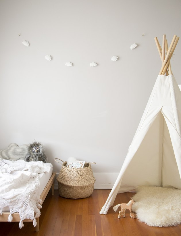 gray minimalist girl bedroom with fort