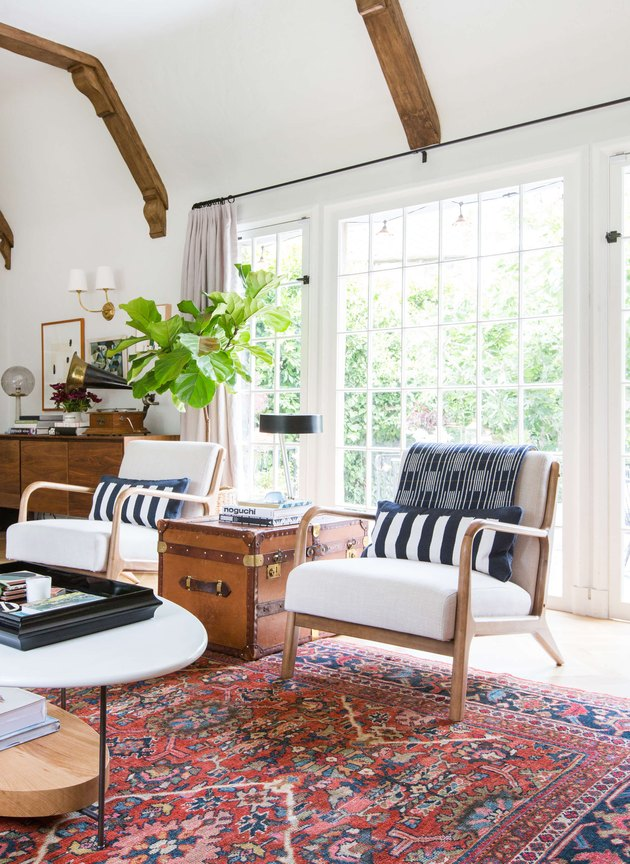 rustic family room ideas with exposed wood beam ceilings and colorful vintage rug