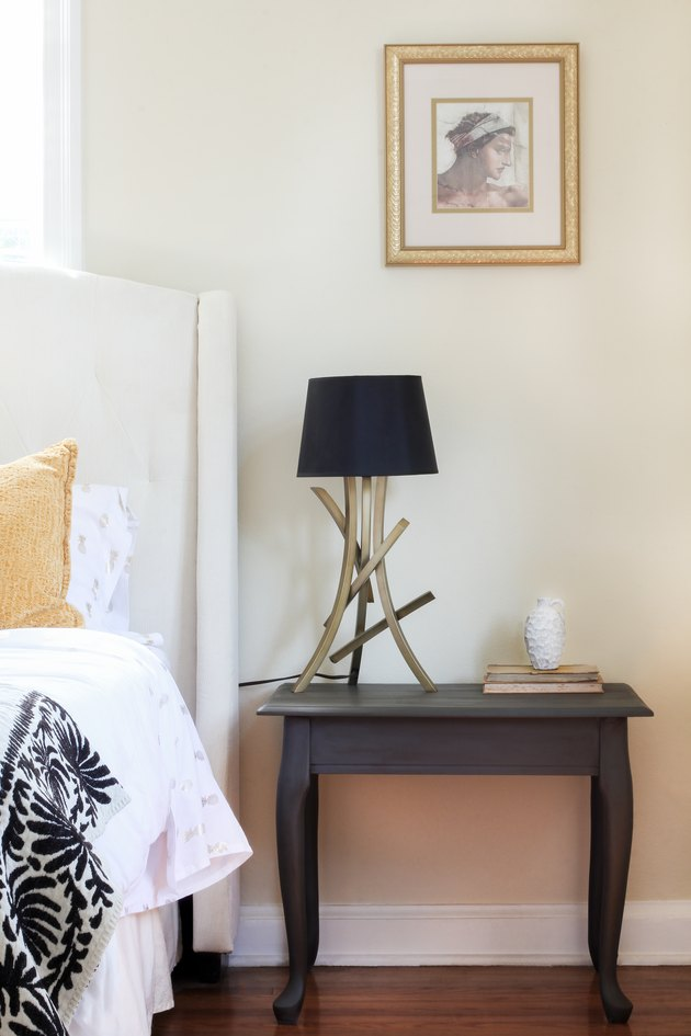 Chalk painted end table styled in bedroom