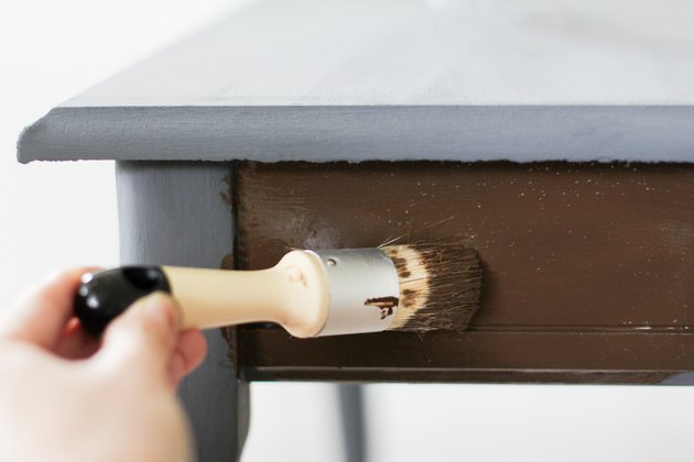 Applying antique wax to end table
