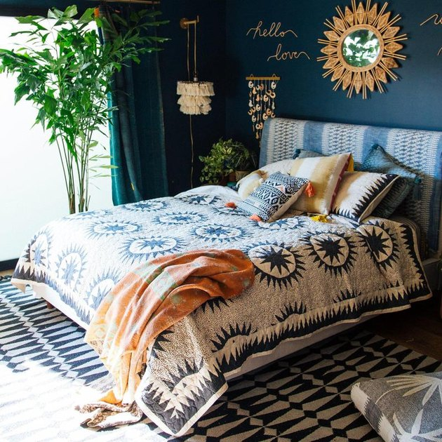 blue bohemian bedroom idea with patterned headboard and bedding
