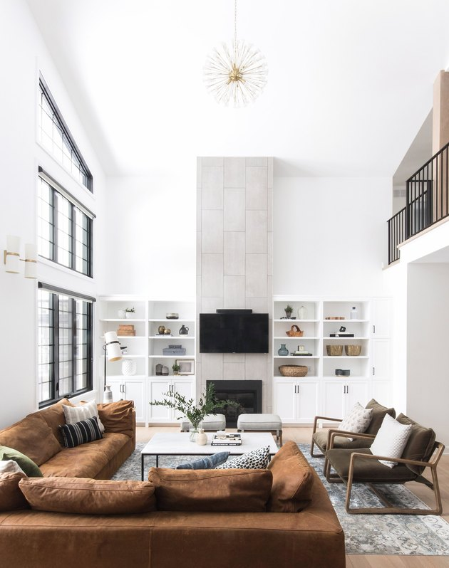 rustic family room ideas with brown couch and gold ceiling light