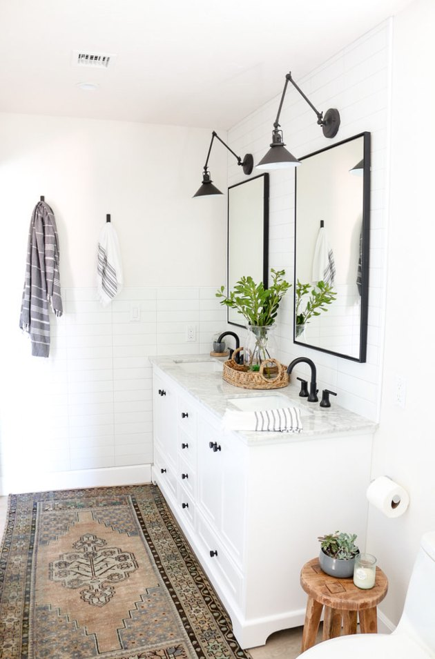 double sink bathroom lighting idea with articulating sconces