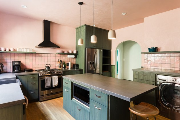 pink and green kitchen; green kitchen island with microwave insert