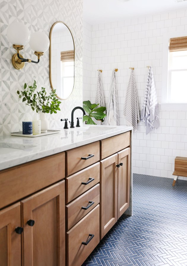 double sink bathroom lighting idea with double arm wall sconce between mirrors