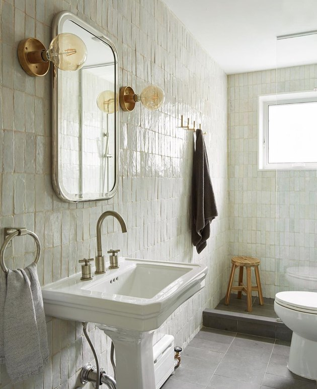 elegant bathroom lighting idea with streamlined gold wall lights