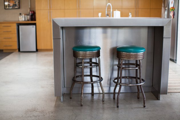 stainless steel kitchen island with two barstools