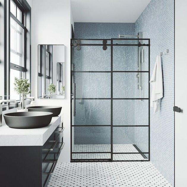 window pane shower door in black and white bathroom
