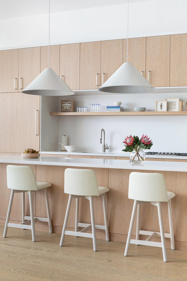 cone-shaped minimalist lighting in neutral kitchen with wood cabinets