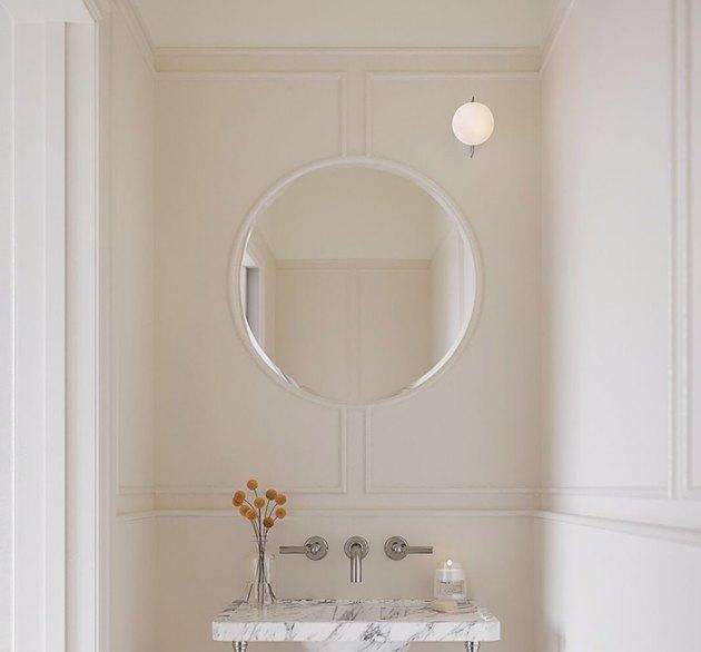 elegant bathroom lighting idea with simple sconce