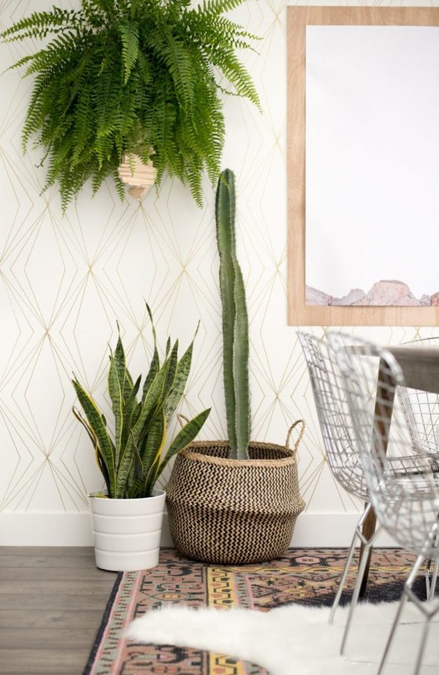 gold and white art deco DIY project with geometric accent wall in dining room
