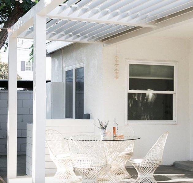 White modern pergola, white dining set