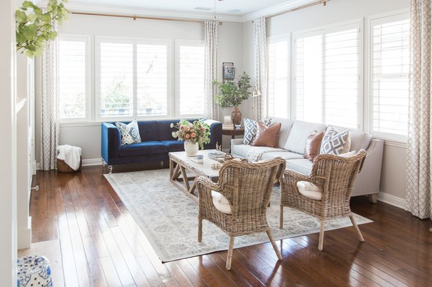 coastal family room with patterned rug and wicker chairs