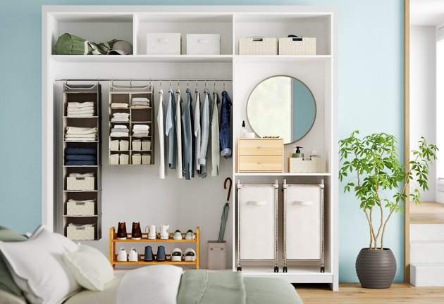 closet system organizer in white and blue bedroom
