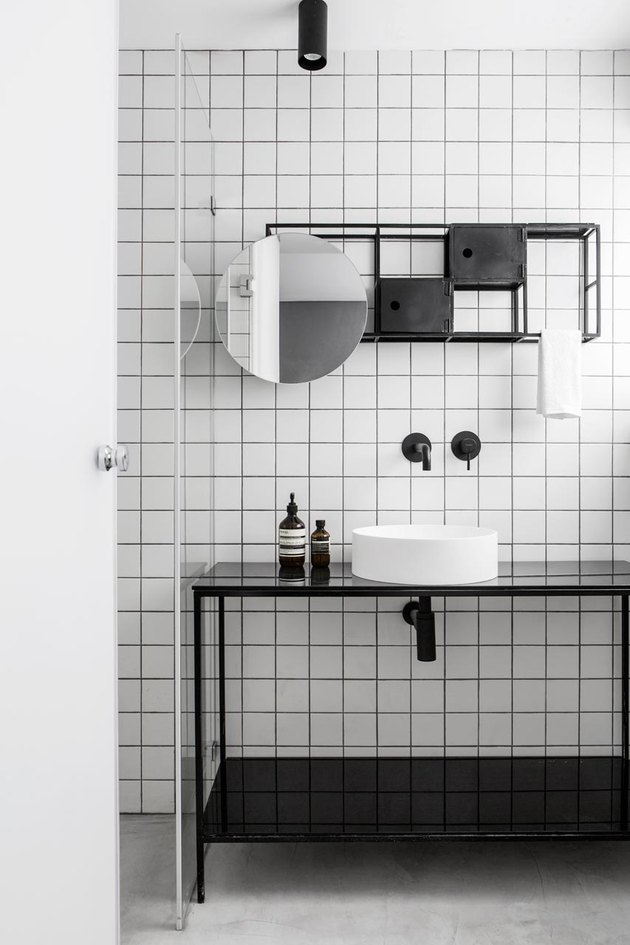 white tile backsplash in bathroom with minimalist bathroom storage