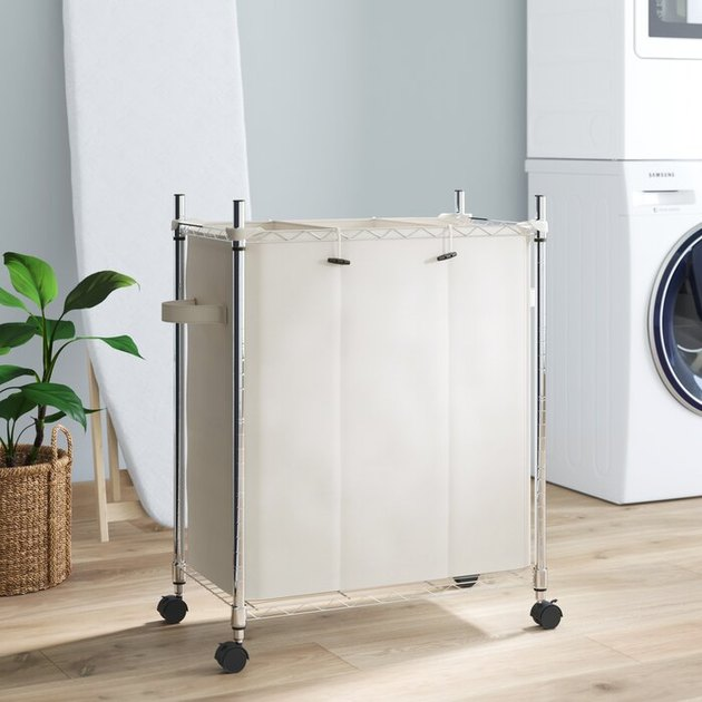 silver and beige rolling laundry sorter