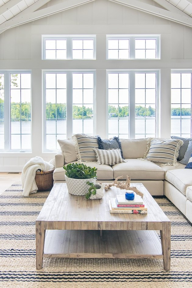 fresh white coastal family room with striped jute rug
