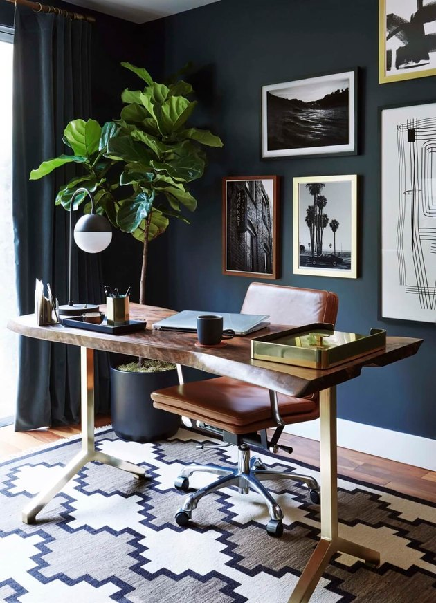 masculine boho decor in dark blue home office with desk and chair