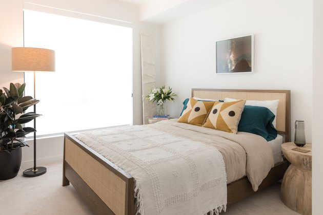 white bedroom with cane bed