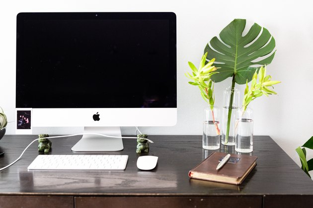 desk with fronds in vases
