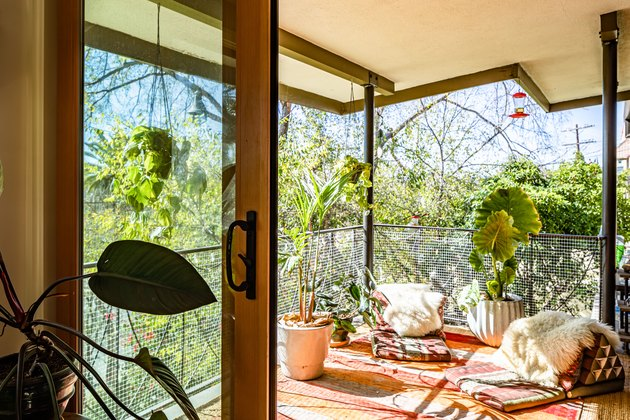 Boho chic balcony with seating area and hanging plants