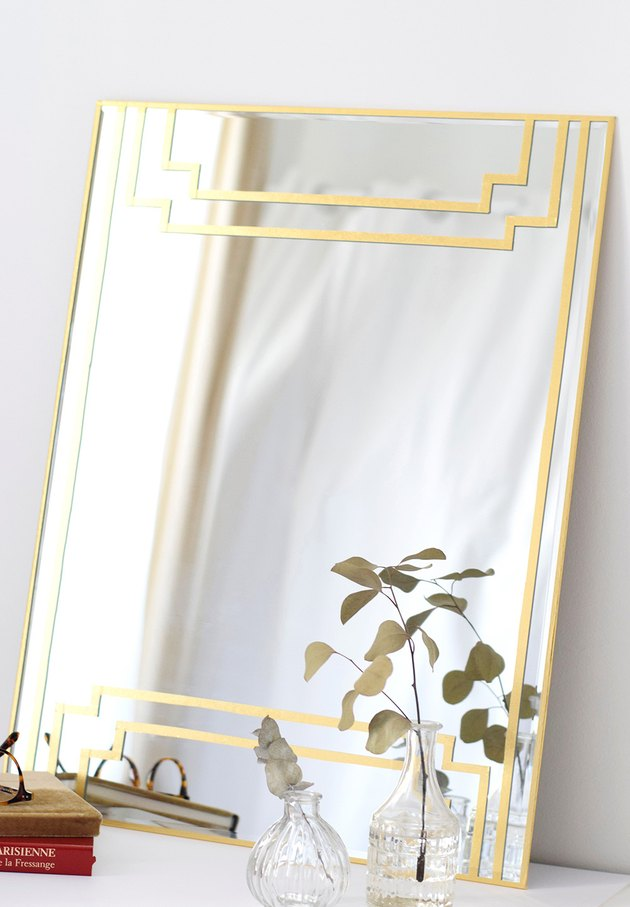 Art deco DIY project with gilded mirror on white tabletop