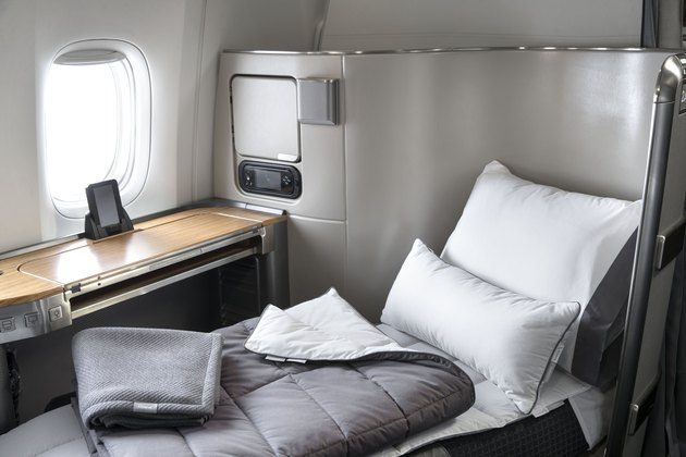 business-class seat with bedding