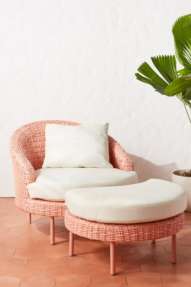 pink chair with white cushions and ottoman