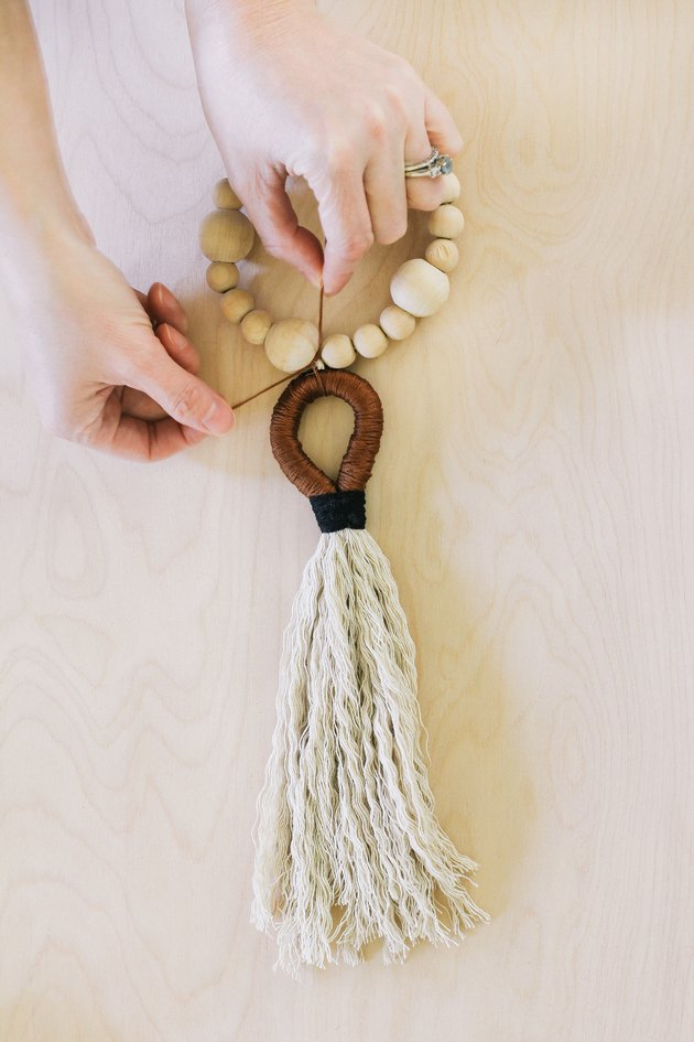 Tying tassel to wood beads