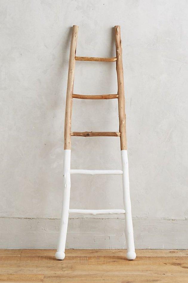 Decorative wooden ladder, lower half painted white