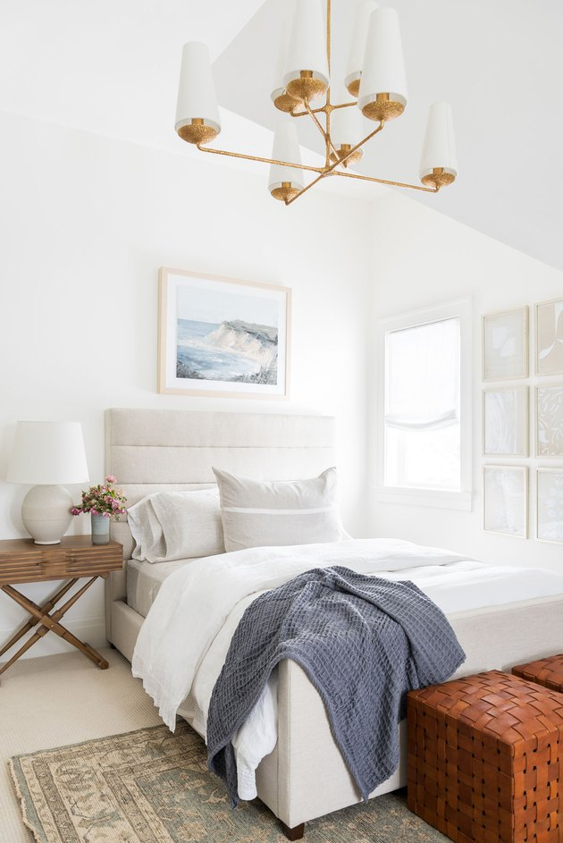 Small master bedroom ideas with upholstered headboard and brass chandelier