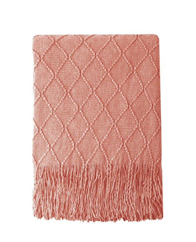 Coral throw blanket with fringe and subtle diamond detail