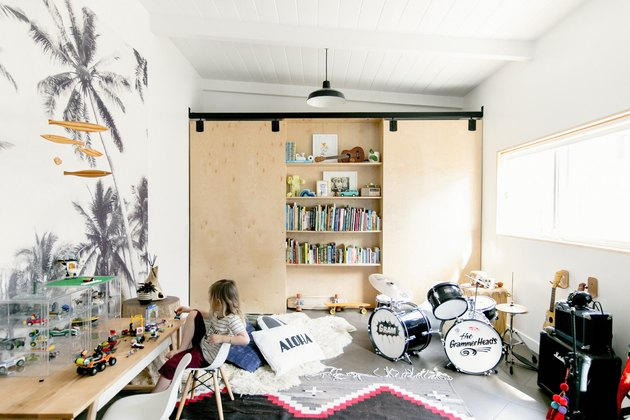 Playroom with musical instruments and toys and hidden bookshelf