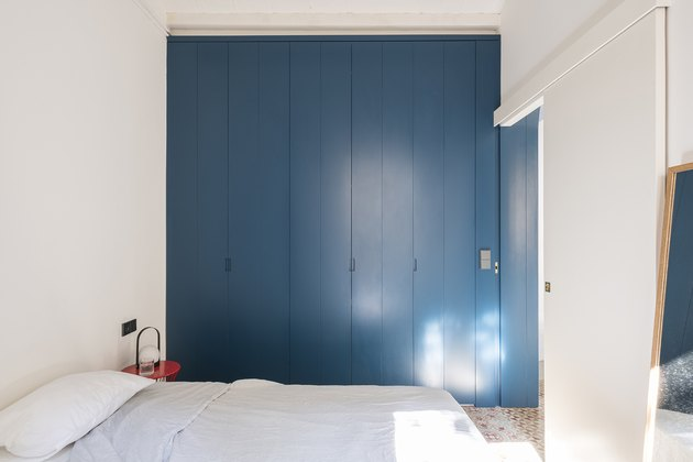 white bedroom with blue paint color closet doors